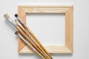 Wooden stretcher bar, paintbrushes