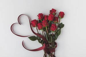 beautiful red roses with ribbon