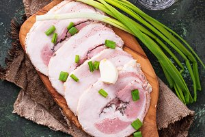 Slices of bacon with green onion and garlic