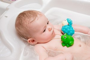 Baby bathing in the bath
