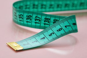 Close-up of green measuring tape