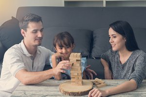 happy family and Daughter play block
