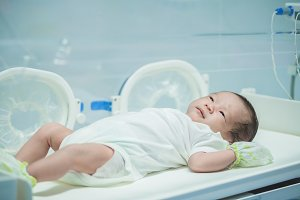 newborn baby girl get light therapy