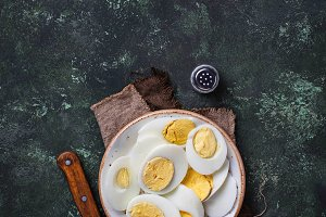 Boiled sliced chicken eggs on plate