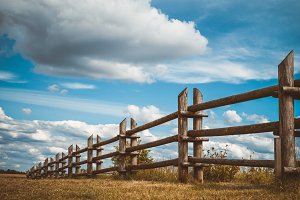 Wooden rustic fence and sky