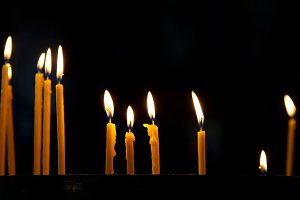 Several tall candles