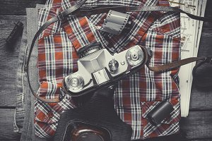 Plaid shirt, jeans and old camera