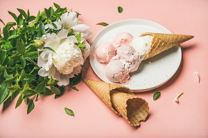 Strawberry and coconut ice cream, cones, white peony flowers