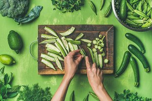 Flat-lay of healthy green vegan cooking ingredients