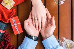 boyfriend holding girlfriends hand