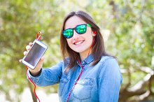 Happy teenager with smartphone
