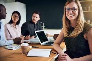 Confident businesswoman smiling during a boardoom meeting in an office