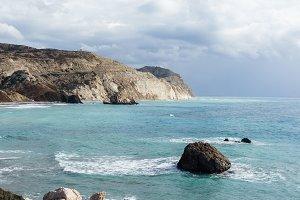 Photo of sea, rocks, rocky slope, cloudy sky