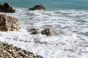 Picture of frothy sea, pebble beach, stones