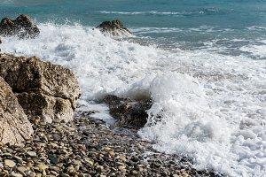 Picture of foamy sea, pebbles