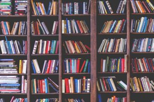 Toned image of colorful books in shelves
