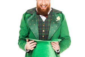 handsome man in leprechaun costume
