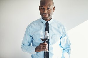 Sophisticated mature man drinking a glass of red wine