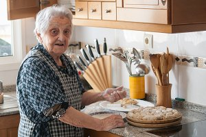 Elderly woman with croquettes