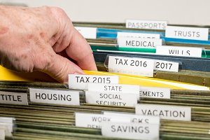 Home filing system for taxes organized in folders