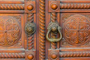 Old Wooden Door Detail With Rusty Ring Doorknobs
