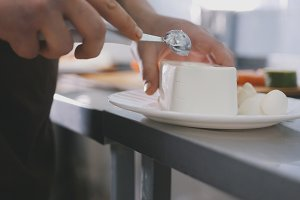 Chef cuts the cheese in commercial kitchen