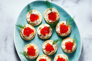 appetizer of red caviar and cheese w