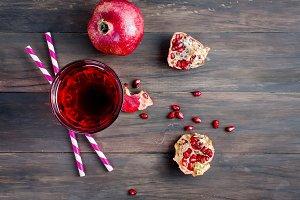 Pomegranate juice in glass and pomeg