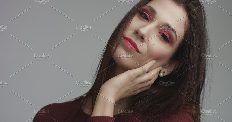 Beauty Spanish Woman In Red Dress With Vivd Red Eye Makeup Looking