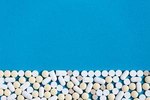 White Medical Pills On Blue Backgrou