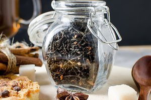 Jar with tea, homemade cookies and