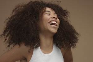 mixed race black woman portrait with big afro hair, curly hair