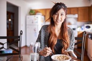 asian teen girl eating breakfast