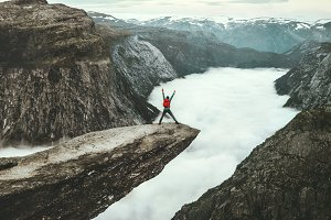 Man jumping on Trolltunga cliff
