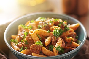 pasta and italian sausage in bowl