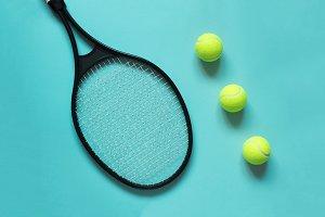 Black tennis balls and racket