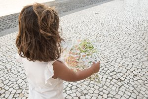 Little girl reading a stray