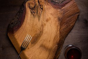 Rustic chopping board, glass of wine