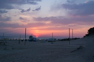 Summer sunset on the sandy beach of the Black Sea