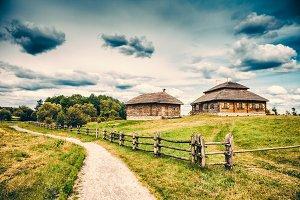 Ethno houses on rural lanscape