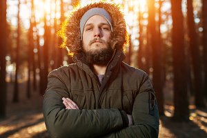 Bearded serious man in parka
