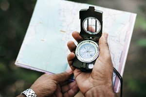 Man using a compass and a map