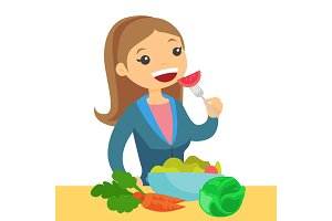 Caucasian woman eating healthy vegetable salad.