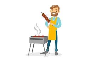 Young caucasian white man cooking shashlik.