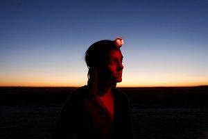 Traveler wearing headlamp