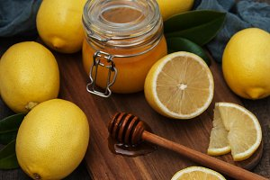 Jar of honey and fresh lemons