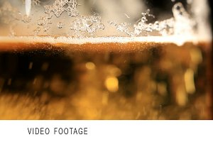 Pouring beer. Macro shot.