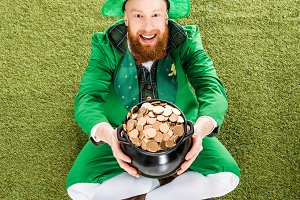 excited man in leprechaun costume