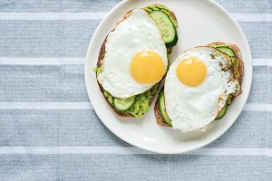 Toast with avocado, egg and cucumber