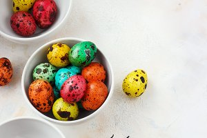 Colored easter eggs on a light backg